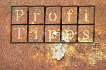 Profi Tipps auf eine Mauer geschrieben