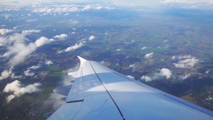 flying above London and looking outside the window of airplane