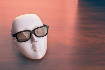 Theater mask in glasses