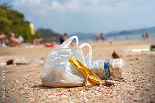 Garbage on a beach, environmental pollution concept picture. - 76656538
