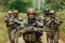 "Постер, картина, фотообои ""sniper stands with arms and looks forward"""