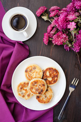 Delicious homemade cheese pancakes with black coffee