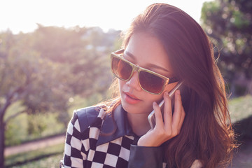 portrait of beautiful woman listening on mobile phone use for pe