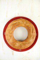 Homemade wreath cake on red plate
