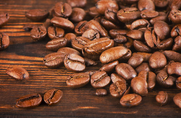 Coffee beans on  old  background