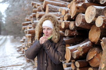 the woman poses against logs