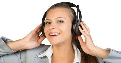 Businesswoman in headset with her hands on speakers