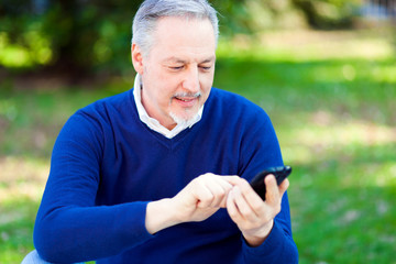 Mature man using a cell phone