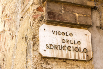 """Vicolo dello Sdrucciolo"" means ""slippery alley"" in Italian."