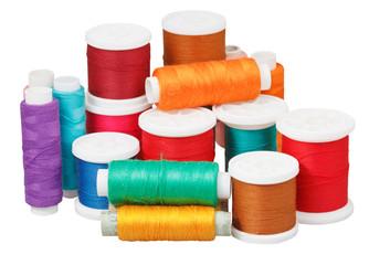 various thread bobbins isolated on white