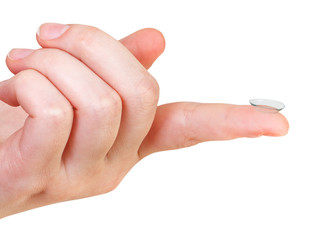 contact lens on the index finger of female hand