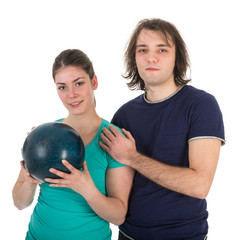 Cheerful young man and woman with bowling ball