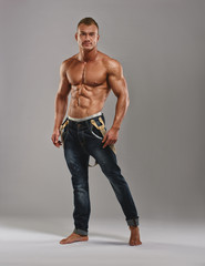 Muscled athlete in jeans