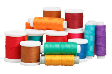 various thread spools isolated on white