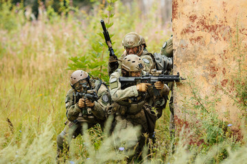group of soldiers attacking from behind cover