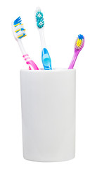 three tooth brushes in ceramic glass