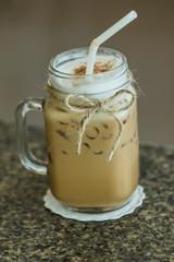 Fresh ice coffee in big glass with straw