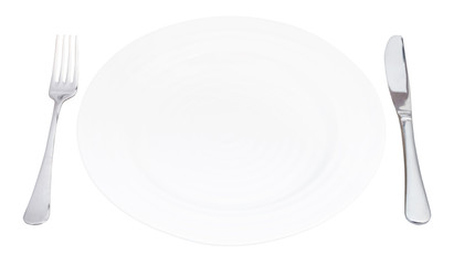 empty white plate with fork and knife isolated