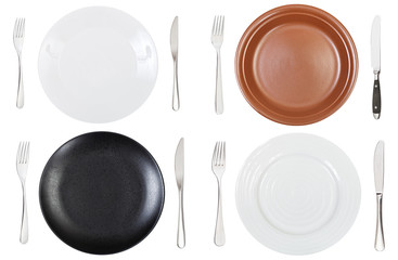 top view of empty dinner plates, forks and knifes