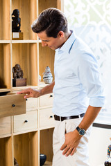 Man at cabinet in furniture store showroom