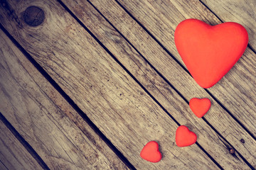 Hearts on wood background