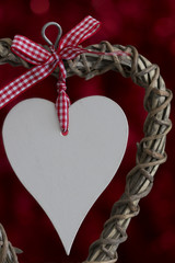 Wooden Heart with Ribbon on Red