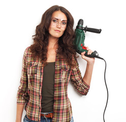 Image of smiling woman with drill over white background
