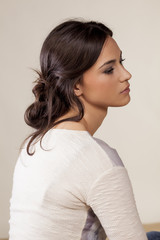 young woman with a loosely clenched hair