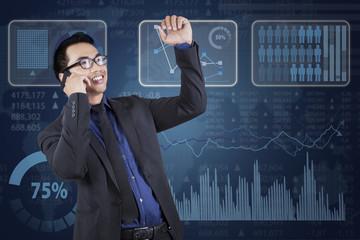 Businessman calling near financial statistics