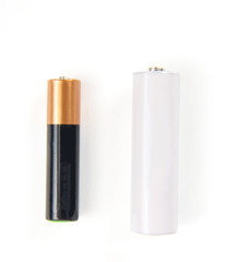 smaller aaa and bigger aa battery on white background