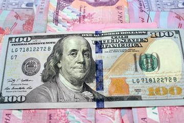 hundred dollars on the Ukrainian grivnas banknotes background