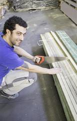 Worker cuts wood