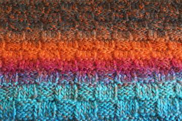Wool texture. Fragment of wool handmade scarf.