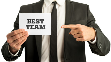 Businessman displaying a card - Best Team