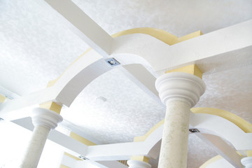 designer ceiling architecture with lines and columns