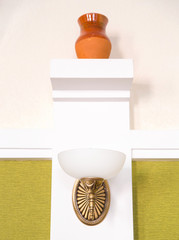 Classic sconce on the modern room wall