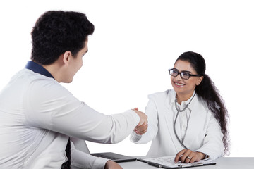 Friendly dentist give greeting to patient