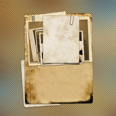Set of old archival papers and vintage postcard on abstract back