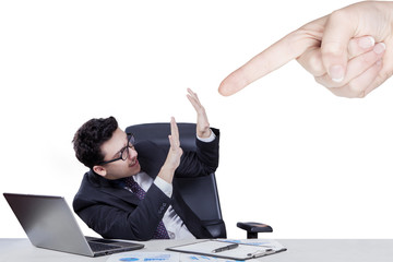Hand pointing at caucasian businessman