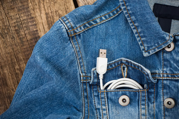 white USB cable in jeans pocket, USB cord with the jeans pocket