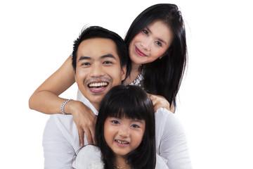 Joyful family in the studio