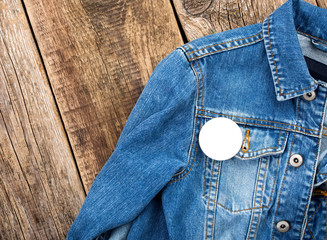 White round badge button on denim jacket