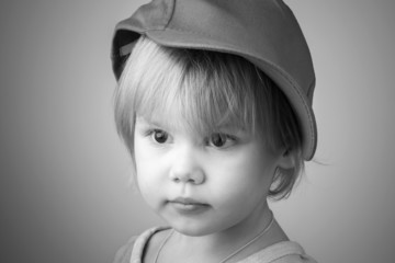 Caucasian baby girl in big baseball cap
