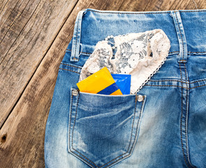 A young man in jeans with a woman's panties and condoms in his p