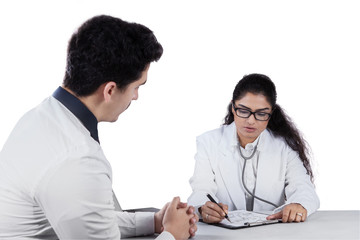 Male patient consulting with personal doctor