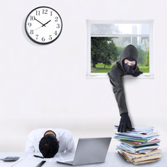 Male robber stealing corporate documents