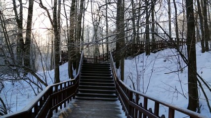 Winter forest, lit by the sun, the stairs in the forest