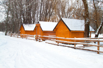 sign board and new yellow wooden house in winter forest