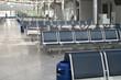 Leinwandbild Motiv Inside airport - airport seating in big airport