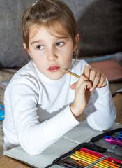 Little schoolgirl doing her homework